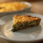 Spinach Quiche - This savory deep-dish pie features herbed feta cheese that melts and mingles in every bite. The cheese is sauteed and mixed with spinach, mushrooms, Cheddar cheese and lots of garlic. This mixture is then combined with milk and eggs, and poured into a prepared crust. A bit more Cheddar cheese is sprinkled over the top, and then the quiche is slipped into the oven until it 's set.