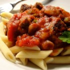 Pasta Sauce with Italian Sausage - A flavorful homemade recipe for those who like meaty, savory sauces. Serve over your favorite pasta with a tossed green salad and crusty garlic bread.