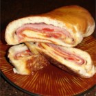 Stromboli - A pizza with the filling in the middle! Pizza dough is slathered with sauce, then stuffed with ham, sausage, salami, pepperoni, mozzarella cheese, and a few vegetables.