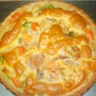 Chicken Pot Pie IV - Chicken, cheese and broccoli make a winning combination in this savory pie. There 's also cream of chicken soup, carrots, and lots of diced chicken baked up into this wonderful 9-inch pie.