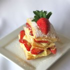 Strawberry Napoleons - Puff pastry, creamy pudding, and fresh strawberries are layered to make this super-easy dessert.