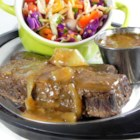 Slow-Cooked German Short Ribs - Beef short ribs and onions slow cooked in a spicy red wine sauce. Goes great over wide egg noodles.