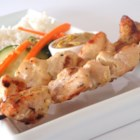 Easy Chicken Satay - These delicious chicken skewers are packed full of flavor! As if that wasn't enough, a tangy coconut-peanut sauce takes it over the top.
