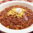Cowboy Stew I - Browned ground beef and sauteed onions are combined with cans of chili, baked beans and cream-style corn in this spicy stew.