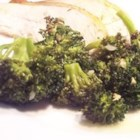 Broccoli in Roast Chicken Drippings - Split breast chicken roasted with my favorite seasonings blend, taken out of the oven to rest.  In its place, fresh broccoli spears and sliced garlic roasted until tender.  Pure laziness, pure genius.