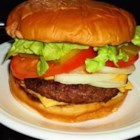 Brandi's Best Burgers - These burgers are definitely crowd pleasers! Perfect for family get-togethers and summer cookouts. They are complimented nicely by baked beans and potato salad. Serve between sesame seed or whole wheat buns and, if desired, plenty of lettuce, tomato, onion and pickles. I also like to use Hickory flavored wood chips when I BBQ to add additional flavor to the meat. If you use wood chips, soak them in water for about an hour, then spread them over the hot coals just before grilling.