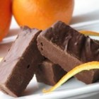 Chocolate Orange Fudge - A simple fudge recipe combining semisweet chocolate chips, condensed milk, pecans and grated orange peel.  Use almonds, or any kind of nut, if desired.