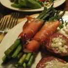 Prosciutto Wrapped Asparagus - A few spears of asparagus, some slices of prosciutto, and a bit of creamy Neufchatel cheese is all you need to assemble this fancy little side dish. Make a few more, and serve them on an appetizer tray.