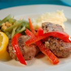 Portuguese Pork with Red Peppers - Lemon slices top garlic coated pork medallions and sauteed red bell peppers in this elegant yet easy dish.
