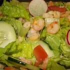 Shrimp Garden Salad - Go out into your garden and pick the following  - lettuce, tomatoes, cucumbers, radishes, green onions and celery. Wash, chop, and toss into a salad bowl with a few lovely shrimp, and your favorite dressing. That's it!