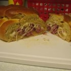 Rueben Loaf - If you like a Reuben sandwich, you love this bread. Mustard flavored bread dough with corned beef and sauerkraut folded inside. Try it at your next tailgate party!