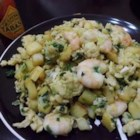 Spanish-Style Scrambled Eggs - Simple scrambled eggs get a Spanish-style upgrade, with leeks, potatoes, and fresh shrimp. Done in just a few minutes, this easy recipe is great for brunch, lunch, or a light supper. The yellow eggs, pale green leeks, and pink shrimp look pretty, too.