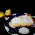 Magic Lemon Pie - Sweetened condensed milk, egg yolks and lemon juice are combined and poured into a graham cracker crust. Egg whites are sugared, beaten into a stiff meringue and spooned onto the lemon filling. The pie is then slipped into a hot oven until the meringue turns golden.
