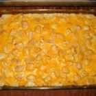 Mexican Casserole - Green chile peppers, leftover cubed chicken breast, creamy soups, milk, sour cream and cheese make this a spicy, creamy casserole treat. This easy casserole is all my family requests!  It can be made more or less spicy, depending on your preference and is equally as tasty if you use all low-fat ingredients.
