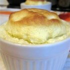 Lemon Souffle - An easy recipe for quick lemon souffles that never fails. Lemon curd is topped with a lemony souffle and baked into a light dessert.