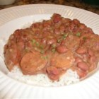 Red Beans and Rice - Red beans and a ham hock slowly simmer with seasonings for maximum flavor. Smoked sausage is stirred in towards the end for a hearty, hot meal that's perfect when the cold winds blow.