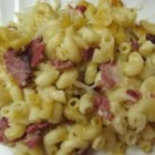Canned  Rueben - Here is a clever twist on a traditional deli sandwich! Macaroni is baked with a tasty concoction of corned beef, sauerkraut, mozzarella cheese and cream of mushroom soup. Rye bread crumbs over the top adds a dash of authenticity.