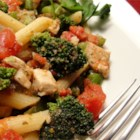 Pasta, Broccoli and Chicken - Chopped tomatoes and pesto add zesty flavor to blanched broccoli tossed with chicken and rigatoni. Parmesan cheese and a fresh grind of black pepper complete the dish.