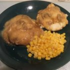 Baked Chicken-Fried Steak with Mushroom Gravy - Chicken-fried steaks with creamy mushroom gravy are baked for an easy, homey dinner.