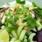 Thai Cucumber Salad - This sweet and tangy summer salad of cucumber, cilantro, and peanuts with just a hint of heat is always a hit at picnics and potlucks.