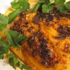 Salmon with Harissa - Fiery harissa and smoky paprika in a mayonnaise base stand up to the distinctive flavor of the mighty wild salmon. The fish is baked with lemon and onion, then broiled for a nicely browned finish.