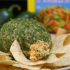Tailgating Spicy Taco Cheese Ball - These spicy cheese balls are so easy to make and perfect for your next football party! Serve with tortilla chips or your favorite buttery crackers for a knock-your-socks-off snack.