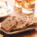 Chai Cake for Bread Machines - This yeasted snack bread combines chai mix flavors along with frozen raspberries, walnuts, rye flour, and caraway seed for a unique combination.