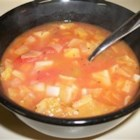Cabbage, Potato, and Tomato Soup - A quick, budget-friendly soup that is great for using up extra vegetables in your cabinet or fridge. Serving this with crusty bread makes a great warming meal in wintertime. Add beef or chicken in with the vegetables for a heartier meal option.