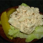 Bud's Potato Salad - In this yummy salad, sliced and cooled potatoes are doused with a vinegar, sugar, and water bath and chilled for twelve hours. At the last moment, mayonnaise, celery seeds, and diced onion are folded in.