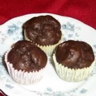 Gluten Free Chocolate Cupcakes - A delicious gluten free cupcake recipe using rice and millet flour.  The millet lends a bit of a cornbread taste to it.  This could also be made into a 8 or 9 inch cake, or without the cocoa powder for a white cake.