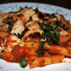 Rigatoni with Italian Chicken - Marinated chicken breasts are cooked in butter and served over rigatoni tossed with Italian-seasoned tomatoes.