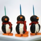 Cream Cheese Penguins - Just imagine a cute display of penguins, made with black olives, carrots and cream cheese! You can add scarves and hats by using fresh red pepper strips, or canned pimentos cut into different shapes. Use frilly toothpicks if you can.