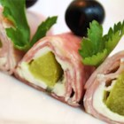 Yummy Roll Ups - Yummy ham, pickle and cream cheese roll ups for an appetizer or a party! Secure the roll ups with toothpicks, and cut them into bite size pieces.