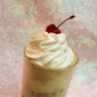 Gourmet Root Beer Float - Tall glasses overflowing with root beer and vanilla ice cream. Top with whipped cream and cherries for a touch of elegance.