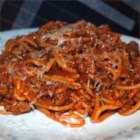 Speedy Spaghetti - Spaghetti simmer directly in a delicious beef and tomato sauce with seasonings.