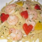 Scrumptious Shrimp Scampi Linguine - Tender pink shrimp and red and yellow bell pepper simmer in a flavorful garlic sauce with a hint of cream and the zing of crushed red peppers, all tossed with linguine and served hot.