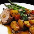 Apple Glazed Pork Tenderloin - A pork tenderloin is seared, coated with a sweet and tangy blend of apple jelly and balsamic vinegar, and baked with wine-flavored onions and apples for a delicious fall main dish.