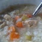Chicken, Rice and Vegetable Soup - Bite-sized pieces of chicken breast are simmered in chicken stock enriched with bouillon cubes, in this soup with carrots, celery and white rice.