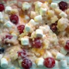 Acini di Pepe Salad - Tiny pearls of acini di pepe are marinated in a fruity custard and tossed with crushed pineapple, mandarin oranges, whipped topping and mini marshmallows to make a bright, refreshing pasta salad. Top with Maraschino cherries for eye-popping color.