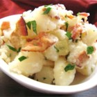 Authentic German Potato Salad - Bacon gives this warm German potato salad recipe a boost of flavor. The vinegar and sugar dressing on this salad has the perfect combination of salty and sweet.