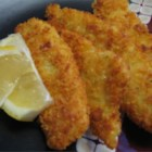 Crispy Fish Fillets - Delicious sole dredged in an egg and mustard mixture, then potato flakes; pan fried to a golden brown. Serve with lemon wedges and tartar sauce.