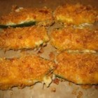 Jalapeno Poppers I - Sharp Cheddar cheese is the rich, delicious filling for these spicy favorites! They are baked rather than deep fried. You'll want to pop them down one after another!
