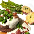 Grilled Filet Mignon with Gorgonzola Cream Sauce - Tender filet mignon is drizzled with a savory Gorgonzola cream sauce and topped with crumbled bacon bits and sliced green onions.