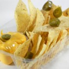 Nacho Cheese Sauce - Here's a simple cheese sauce to spread over tortilla chips. Add some jalapenos to spice things up a bit.
