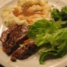 Round Steak and Gravy II - Succulent round steak seared, then braised in cream of mushroom and French onion soups until tender. Great with mashed potatoes, as it makes it's own gravy.