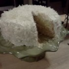 Fresh Coconut Layer Cake - This triple-layer cake is baked, frosted and filled with intense coconut flavor derived from the use of fresh coconut, coconut milk and coconut cream.