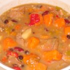 Southwestern Green Chile with Pork Stew - Browned cubes of pork loin are cooked with potatoes, green chilies and lots of garlic in this chicken broth based stew with black and kidney beans.