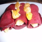 Beetroot Pancakes - These crepe-like rolled pancakes, dusted with cinnamon sugar and served with orange segments, are a colorful variation on a South African dessert favorite.