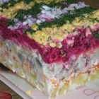 Russian Beet Salad with Herring - Onion, herring, potatoes, carrots, and beets are layered in this Russian salad.