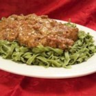 Chicken with Sun-Dried Tomato and Roasted Pepper Cream Sauce - Chicken breasts are simmered in a creamy pink sauce with sun-dried tomatoes and roasted red peppers, then served on green spinach fettuccine for a colorful and delicious main dish.